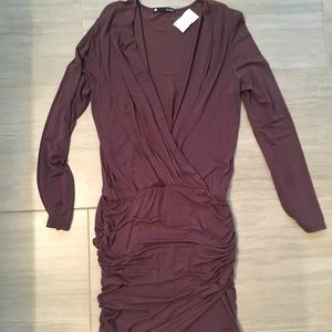 Plum long sleeve mini dress with ruched skirt